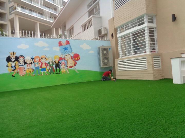 thảm cỏ nhân tạo lót sân vườn cho bé chơi